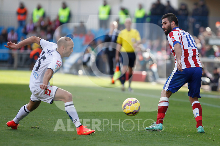 Atletico de Madrid´s Arda Turan (R) and Deportivo de la Coruña´s Laure during 2014-15 La Liga match between Atletico de Madrid and Deportivo de la Coruña at Vicente Calderon stadium in Madrid, Spain. November 30, 2014. (ALTERPHOTOS/Victor Blanco)