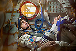 In the Integration Facility at the Baikonur Cosmodrome in Kazakhstan, Expedition 38/39 Flight Engineer Rick Mastracchio participates in a fit check dress rehearsal in the Soyuz TMA-11M spacecraft October 28 with his crewmates, Soyuz Commander Mikhail Tyurin and Flight Engineer Koichi Wakata of the Japan Aerospace Exploration Agency. The trio will launch Nov. 7, Kazakh time, in the Soyuz spacecraft from Baikonur to begin a six-month mission on the International Space Station.<br /> <br /> NASA/Victor Zelentsov