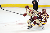 Steven Whitney (BC - 21), Luke McManus (Duluth - 22) - The Boston College Eagles defeated the University of Minnesota Duluth Bulldogs 4-0 to win the NCAA Northeast Regional on Sunday, March 25, 2012, at the DCU Center in Worcester, Massachusetts.