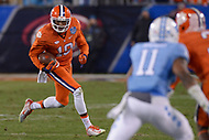 Charlotte, NC - December 5, 2015: Wide receiver Charone Peake, #19 of the Clemson Tigers, runs the ball in the ACC Football Championship game between the North Carolina Tarheels and Clemson at the Bank of America Stadium in Charlotte, North Carolina, December 5, 2015. Clemson defeated North Carolina 45-37.  (Photo by Don Baxter/Media Images International)