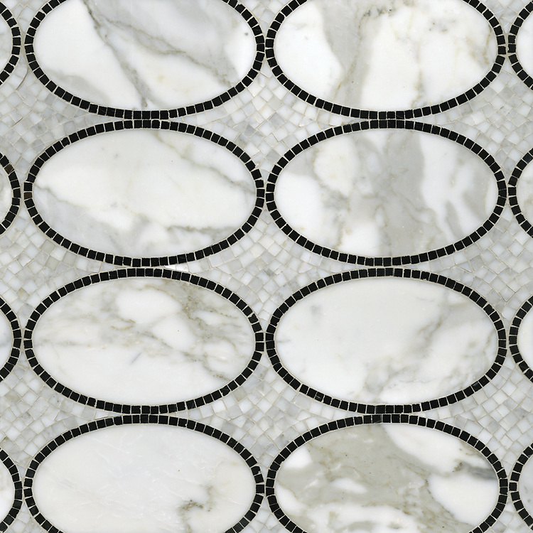 Solid Ovals, a waterjet and hand-cut stone mosaic, shown in Calacatta Tia and polished Nero Marquina, is part of the Silk Road® collection by New Ravenna.
