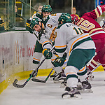 20 February 2016: University of Vermont Catamount Defenseman and Team Captain Yvan Pattyn, a Senior from St. Anne, Manitoba, digs for the puck during the first period against the Boston College Eagles at Gutterson Fieldhouse in Burlington, Vermont. The Eagles defeated the Catamounts 4-1 in the second game of their weekend series. Mandatory Credit: Ed Wolfstein Photo *** RAW (NEF) Image File Available ***