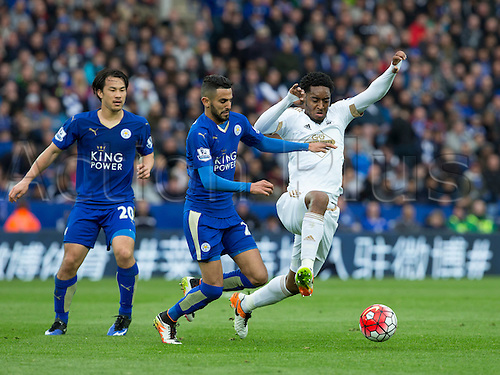 24.04.2016. King Power Stadium, Leicester, England. Barclays Premier League. Leicester versus Swansea.  Swansea City midfielder Leroy Fer comes in hard to say in front of Leicester City midfielder Riyad Mahrez and takes possession of the ball.