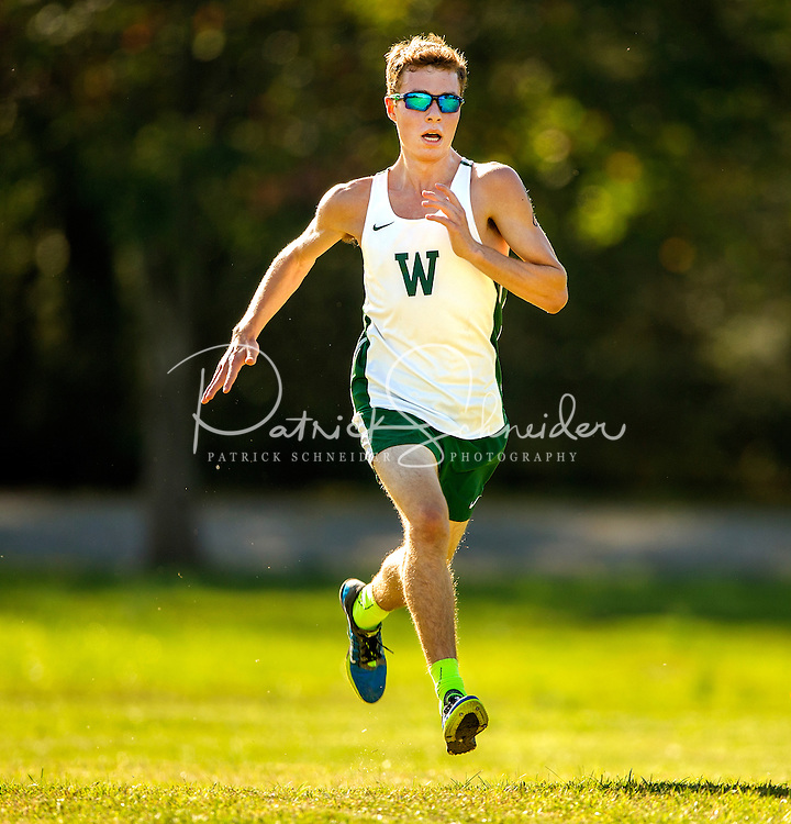 Photography of the Woodlawn School Varsity Cross Country team running SPAA meet at Southside Park, Newton, Monday afternoon October 12, 2015.<br /> <br /> Charlotte Photographer - PatrickSchneiderPhoto.com