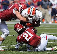 NWA Democrat-Gazette/ANDY SHUPE<br /> Arkansas' Josh Williams (21) and Mitchell Loewen tackle University of Texas at El Paso's Kavika Johnson Saturday, Sept. 5, 2015, during the second quarter of play in Razorback Stadium in Fayetteville. Visit nwadg.com/photos to see more from the game.