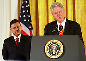United States President Bill Clinton makes remarks during the signing ceremony for the U.S- Jordan Free Trade Agreement in the East Room of the White House in Washington, D.C. on October 24, 2000.  King Abdullah II of Jordan looks on from left..Credit: Ron Sachs / CNP