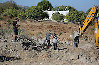 Pictured: A digger assists forensics officers with the preliminary search at the new site in Kos, Greece. Friday 07 October 2016<br />Re: Police teams led by South Yorkshire Police, searching for missing toddler Ben Needham on the Greek island of Kos have moved to a new area in the field they are searching.<br />Ben, from Sheffield, was 21 months old when he disappeared on 24 July 1991 during a family holiday.<br />Digging has begun at a new site after a fresh line of inquiry suggested he could have been crushed by a digger.