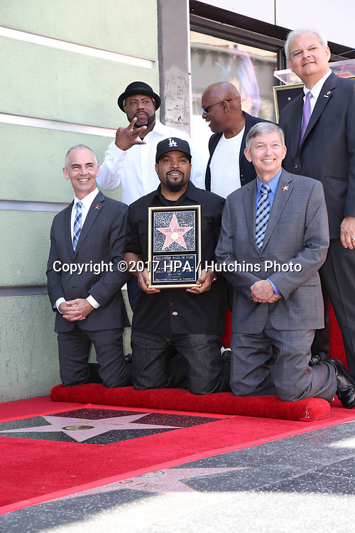 LOS ANGELES - JUN 12:  William Loshawn Calhoun Jr aka WC, Ice Cube, John Singleton, Chamber Officials at the Ice Cube Star Ceremony on the Hollywood Walk of Fame on June 12, 2017 in Los Angeles, CA