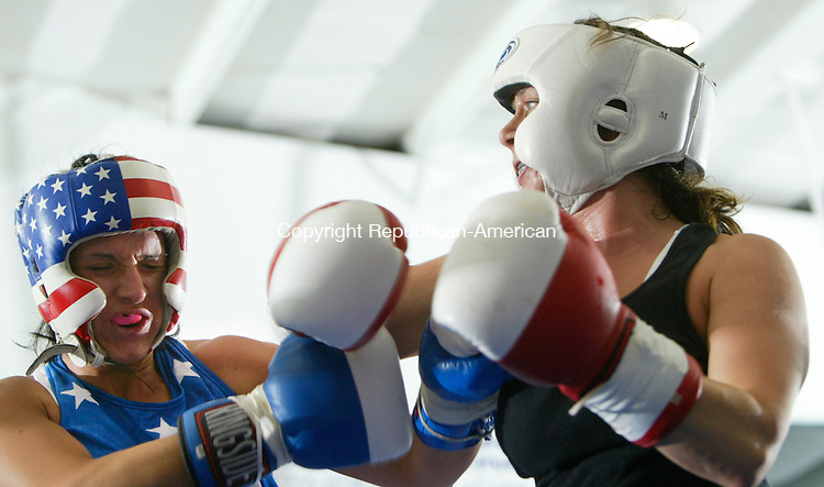 WATERBURY, CT 06/28/08- 062808BZ03- Claudine Palsgrad, left, fights Jennifer DeWitt in the 151 pound novice women's division during the Brass City Championships held at the Waterbury Police Activity League Blasius Rescreation Center in Waterbury Saturday.  DeWitt won the fight by decision..Jamison C. Bazinet Republican-American