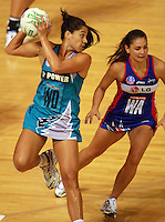 20.03.2010 Mystics Temepara George and Thunderbirds Mo'onia Gerrard in action during the ANZ Champs Netball match between the Mystics and Thunderbirds at Trusts Stadium in Auckland. Mandatory Photo Credit ©Michael Bradley.