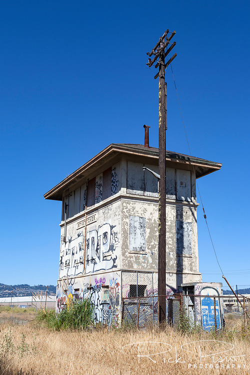 Once part of the Southern Pacific railyard in Oakland the now abandoned 16th St. Tower  sits beside Interstate 880 seperated from the railyard in Oakland, California.