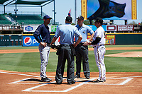 Charlotte Stone Crabs manager Michael Johns (9) meets with Gera Alvarez (18), umpire Mike Carroll and home plate umpire Matt Carlyon before a game against the Bradenton Marauders on April 9, 2017 at LECOM Park in Bradenton, Florida.  Bradenton defeated Charlotte 5-0.  (Mike Janes/Four Seam Images)