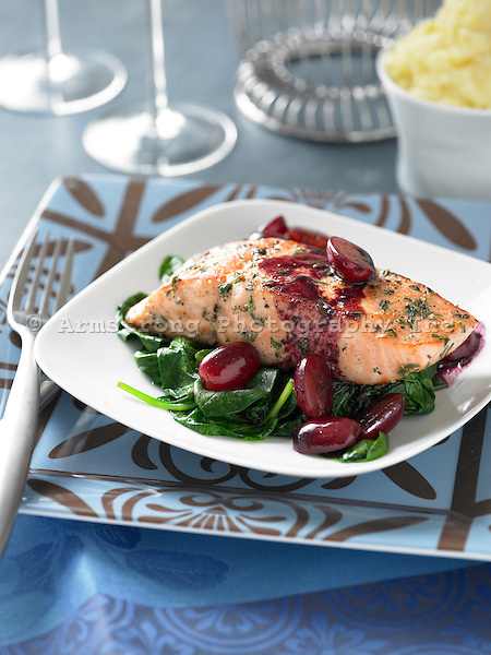 Salmon filet on bed of sauteed spinach, with sauteed grapes