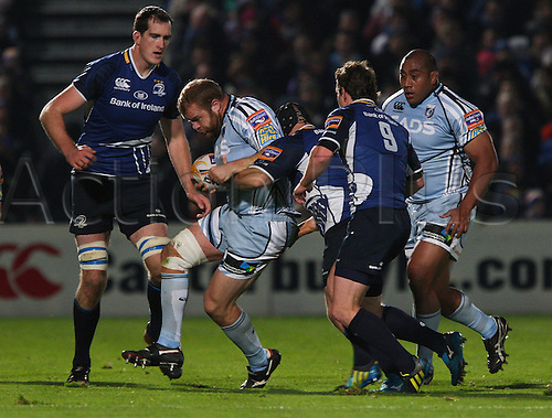 27.10.2012 Dublin, Ireland.Scott Andrews tries to escape the attentions of Richardt Strauss, during the RaboDirect PRO12 game between Leinster and Cardiff Blues from the Royal Dublin Society.