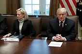 United States President Donald J. Trump, right, talks to reporters next to US Secretary of Homeland Security (DHS) Kirstjen Nielsen, left, during a meeting with conservative leaders on his immigration proposal at the White House on January 23, 2019 in Washington, DC. <br /> Credit: Yuri Gripas / Pool via CNP