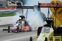 Sept. 1, 2012; Claremont, IN, USA: NHRA top fuel dragster driver David Grubnic blows an engine in smoke during qualifying for the US Nationals at Lucas Oil Raceway. Mandatory Credit: Mark J. Rebilas-