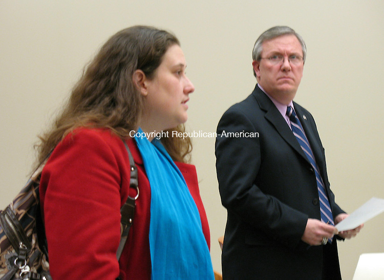WATERBURY, CT - 06 February 2010 - 020510RA01 - Assistant State's Attorney John Davenport listens to Laura Behlman address Judge Richard Damiani at Waterbury Superior Court on Friday. Behlman, of Naugatuck, was arrested Thursday for leaving her 9-year-old son alone.