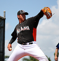 Miami Marlins pitcher Jose Fernandez #44 delivers a pitch in the bullpen before a minor league spring training game against the New York Mets at the Roger Dean Sports Complex on March 28, 2012 in Jupiter, Florida.  (Mike Janes/Four Seam Images)