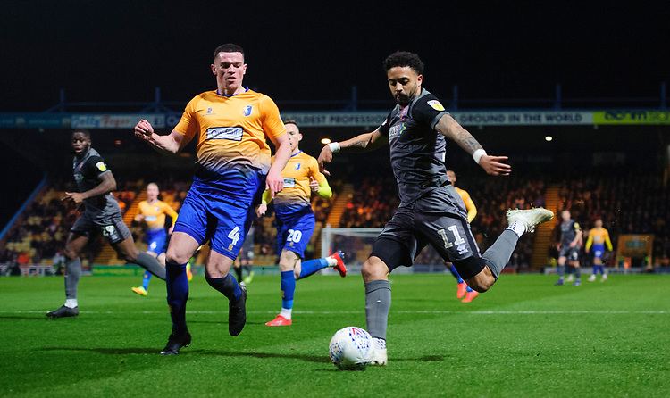 Lincoln City's Bruno Andrade vies for possession with Mansfield Town's Matt Preston<br /> <br /> Photographer Chris Vaughan/CameraSport<br /> <br /> The EFL Sky Bet League Two - Mansfield Town v Lincoln City - Monday 18th March 2019 - Field Mill - Mansfield<br /> <br /> World Copyright © 2019 CameraSport. All rights reserved. 43 Linden Ave. Countesthorpe. Leicester. England. LE8 5PG - Tel: +44 (0) 116 277 4147 - admin@camerasport.com - www.camerasport.com