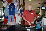 "LOS ANGELES, CA - MARCH 12:  ""One Day One Game"" A stadium vendor checks the cash box before the start of the Los Angeles Clippers against the Golden State Warriors during their NBA Game at the Staples Center  on March 12, 2014 in Los Angeles, California.  (Photo by Donald Miralle for ESPN the Magazine)"