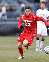 University of New Mexico midfielder Blake Smith (23) brings the ball forward. .NCAA Tournament. With a goal in the second overtime, University of Connecticut (white) defeated University of New Mexico (red), 2-1, at Morrone Stadium at University of Connecticut on November 25, 2012.