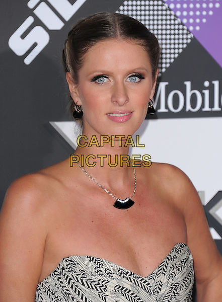 NICKY HILTON .at The T-Mobile Sidekick 4G Launch Party held at a private lot in Beverly Hills, California, USA, April 20th 2011..portrait headshot necklace hair up beauty make-up tanned strapless earrings black print                      .CAP/RKE/DVS.©DVS/RockinExposures/Capital Pictures.
