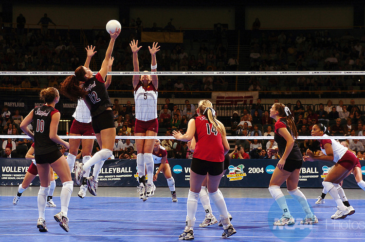 18 DEC 2004:  Jennifer Hucke (12) of Stanford University lofts a shot over two University of Minnesota players hands during the Division 1 Women's Volleyball Championship held at the Long Beach Arena in Long Beach, CA.  Stanford defeated Minnesota 3-0 for the national title.  Matt Brown/NCAA Photos