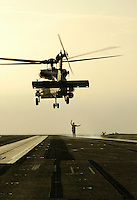Recovering an SH-60F aboard USS Abraham Lincoln.