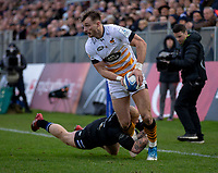 Wasps' Josh Bassett evades the tackle of Bath Rugby's Tom Homer<br /> <br /> Photographer Bob Bradford/CameraSport<br /> <br /> European Rugby Heineken Champions Cup Pool 1 - Bath Rugby v Wasps - Saturday 12th January 2019 - The Recreation Ground - Bath<br /> <br /> World Copyright &copy; 2019 CameraSport. All rights reserved. 43 Linden Ave. Countesthorpe. Leicester. England. LE8 5PG - Tel: +44 (0) 116 277 4147 - admin@camerasport.com - www.camerasport.com