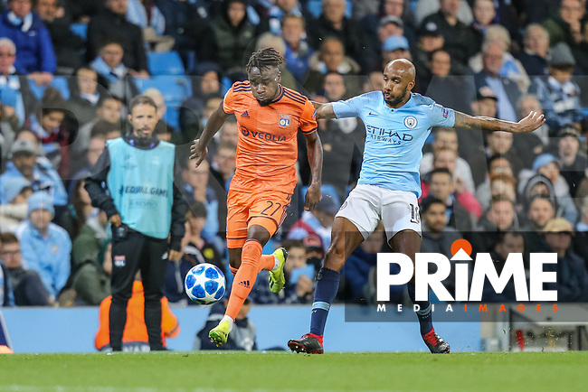 Maxwel CORNET of Olympique Lyonnais and Fabien DELPH of Manchester City battle for the ball during the UEFA Champions League match between Manchester City and Olympique Lyonnais at the Etihad Stadium, Manchester, England on 19 September 2018. Photo by David Horn / PRiME Media Images.