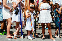 Children hold decorated oars at the edge of the Sunday Procession during St. Peter's Fiesta in Gloucester, Massachusetts, USA.