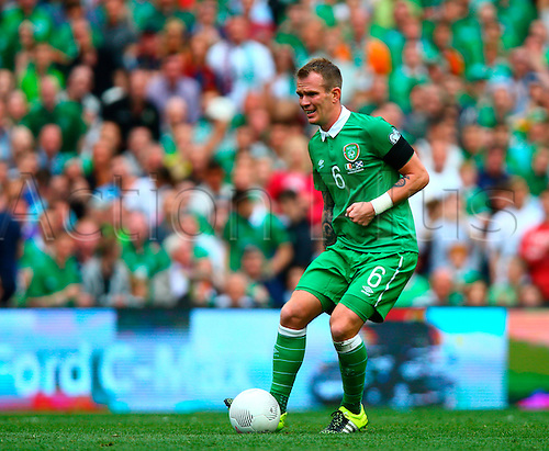 13.06.2015. Dublin, Ireland. Euro2016 Qualifying. Republic of Ireland versus Scotland. Glenn Whelan (Rep. of Ireland) controls the ball.
