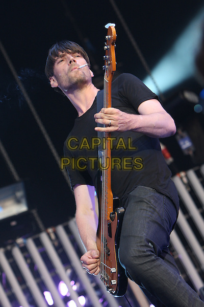 BLUR - Alex James.Performing live at Hyde Park, London, England..July 2nd, 2009.stage concert gig performance music half length black top t-shirt bass guitar 3/4 smoking cigarette .CAP/MAR.© Martin Harris/Capital Pictures.