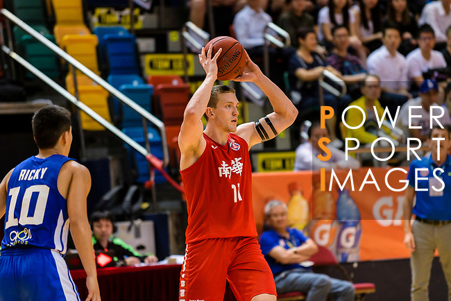 Dominic Robert Gilbert #11 of SCAA Men's Basketball Team looks to pass the ball against to the Eastern Long Lions during the Hong Kong Basketball League playoff game between Eastern Long Lions and SCAA at Queen Elizabeth Stadium on July 24, 2018 in Hong Kong. Photo by Marcio Rodrigo Machado / Power Sport Images
