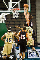 January 9, 2009:     Mercer forward Daniel Emerson (33) goes up over Jacksonville's Lehmon Colbert (41) for a basket in Atlantic Sun Conference action between the Jacksonville Dolphins and the Mercer Bears at Veterans Memorial Arena in Jacksonville, Florida.  Jacksonville defeated Mercer 80-59.