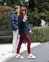 First lady Melania Trump waves to the assembled press as she and Barron Trump join United States President Donald J. Trump as he departs the White House in Washington, DC on Friday, March 8, 2019.  The President will travel to Alabama to see the damage from the tornados earlier in the week before continuing to Florida to spend the weekend at his Mar-a-Lago resort.<br /> CAP/MPI/RS<br /> &copy;RS/MPI/Capital Pictures