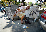 Sadedin Husein, 63, is a Roma man who lives in the mostly Roma town of Suto Orizari, Macedonia, but spends his days at work collecting plastic bottles in the streets of Skopje, which he sells to recyclers.  Here he smashes a bottle he pulled out of a garbage dumpster.