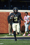 Chuck Wade Jr. (9) of the Wake Forest Demon Deacons warms-up prior to the game against the Notre Dame Fighting Irish at BB&T Field on September 22, 2018 in Winston-Salem, North Carolina. The Fighting Irish defeated the Demon Deacons 56-27. (Brian Westerholt/Sports On Film)