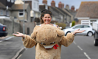 Care bear - The grandmother cheering lockdown children by walking her dog dressed as a bear.