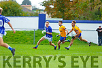 Daire Cleary Laune Rangers breaks away from Gerard Hartnett and Nathan Redmond Beaufort during the Mid Kerry clash in Killorglin on Sunday
