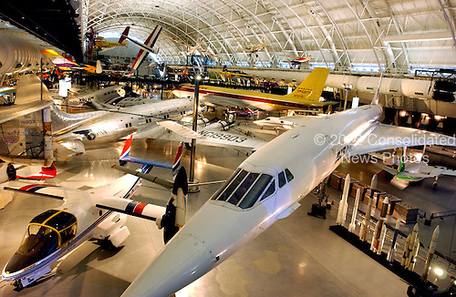 "Chantilly, Virginia - December 5, 2003 -- A wide angle view of part of the exhibit area of the Steven F. Udvar-Hazy Center in Chantilly, Virginia.  The Air France Concorde dominates the foreground.  The Bell XV-15 Tilt-Rotor Research Aircraft is exhibited at lower left.  Also clearly visible are the Boeing 307 Stratoliner ""Clipper Flying Cloud"" at left center and the Boeing 367-80 ""Dash 80"" is at upper center right.  Various other aircraft can be seen on the floor or hanging from the ceiling..Credit: Ron Sachs / CNP.(RESTRICTION: NO New York or New Jersey Newspapers or newspapers within a 75 mile radius of New York City)"