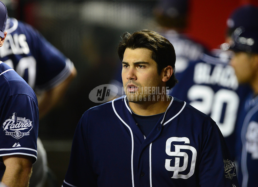 Jul. 3, 2012; Phoenix, AZ, USA: San Diego Padres outfielder Carlos Quentin in the dugout in the third inning against the Arizona Diamondbacks at Chase Field. Mandatory Credit: Mark J. Rebilas-