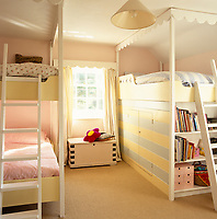 A pair of bunk beds in a well organised child's bedroom