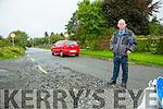 Ballinorig resident Denis Walsh concerned over large pot hole after floods last friday to road users