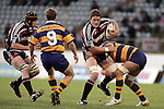 Kristian Ormsby has Andrew Van der Heijden in support as he is taken by Colin Bourke during the Air NZ Cup rugby game between Bay of Plenty & Counties Manukau played at Blue Chip Stadium, Mt Maunganui on 16th of September, 2006. Bay of Plenty won 38 - 11.