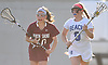 Caitlin Breglia #9 of Long Beach, right, looks to get past Andrea Liotta #20 of North Shore during the Nassau County varsity girls lacrosse Class B quarterfinals at Long Beach High School on Thursday, May 19, 2016. Breglia scored the game-winner in overtime to lead Long Beach to a 9-8 victory.