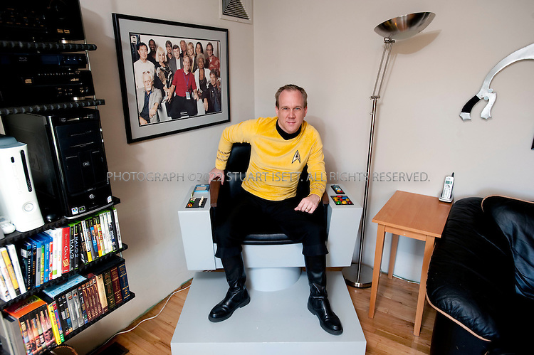 3/11/2009--Auburn, WA, USA..Tod Sturgeon, 40, the manager of a private security firm built a full-size replica of Caption Kirk's chair from the bridge of the U.S.S. Enterprise, as seen in the original Star Trek television series. The chair is made from medium density fiberboard and Sturgeon was consumed with painting it the exact gray. the chair now sits in his family's living room, with other Star Trek paraphernalia...©2009 Stuart Isett. All rights reserved.