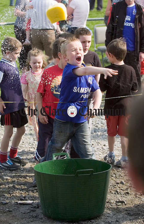 "Plenty takers to throw wet sponges at ""volunteers"" during the Ennis RFC End of Season Barbeque and Fun Day. Photograph by John Kelly."