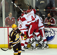 The University of Wisconsin men's hockey team celebrates a goal, as the Badgers tie Minnesota 2-2 on Friday at the Kohl Center in Madison