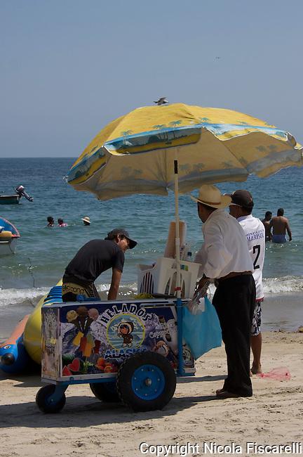 Beach vendor sells ice cream on the beach in Puerto Vallarta -Mexico